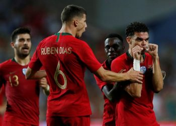 Pepe (R) celebrates with teammates after scoring against Croatia