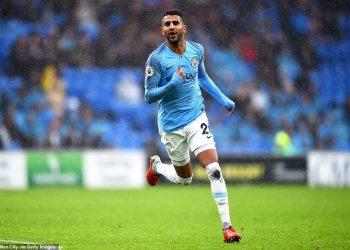 Manchester City's Riyad Mahrez celebrates after scoring against Cardiff City, Saturday