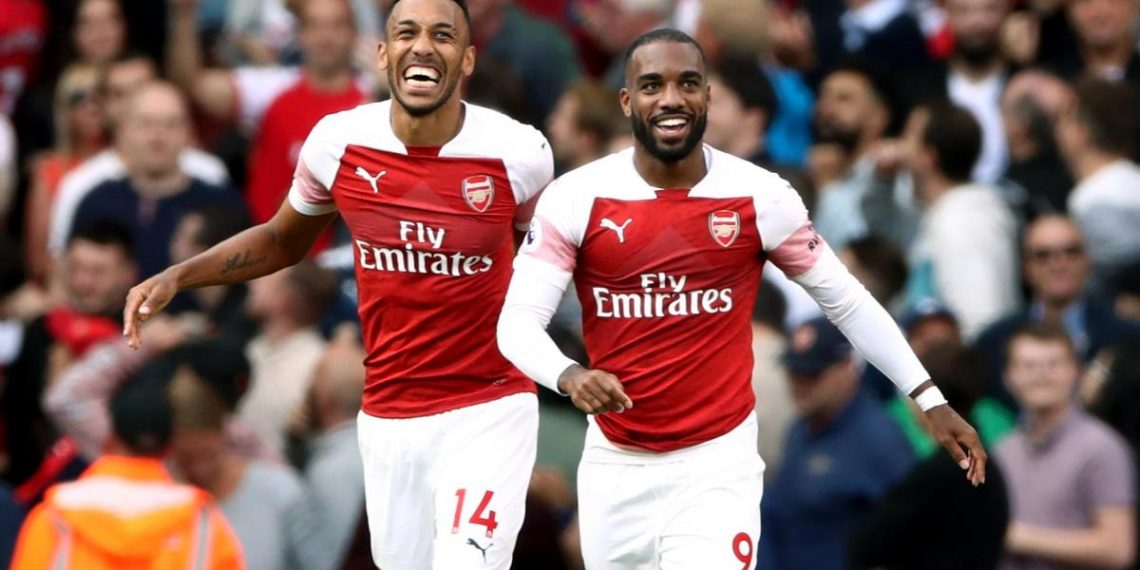 Arsenal's Pierre-Emerick Aubameyang (L) and Alexandre Lacazette celebrate after the latter's winning goal against Cardiff City, Sunday