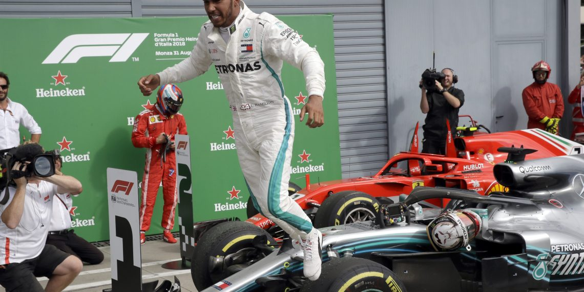 Mercedes driver Lewis Hamilton of Britain celebrates after winning the Formula One Italy Grand Prix at the Monza racetrack