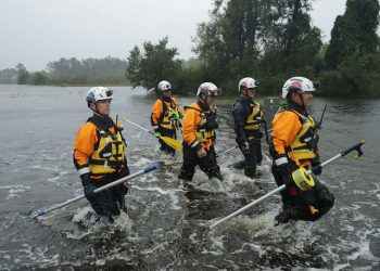 FAIRFIELD HARBOUR, NC - SEPTEMBER 14: Members of the FEMA Urban Search and Rescue Task Force 4 from Oakland, California, search a flooded neighborhood for evacuees during Hurricane Florence September 14, 2018 in Fairfield Harbour, North Carolina. Hurricane Florence made landfall in North Carolina as a Category 1 storm and flooding from the heavy rain is forcing hundreds of people to call for emergency rescues in the communities around New Bern, North Carolina, which sits at the confluence of the Neuse and Trent rivers. (Photo by Chip Somodevilla/Getty Images)