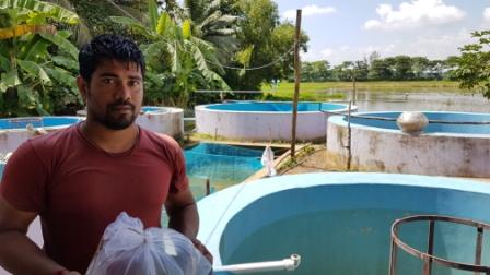 Gyaneswar Sahoo at his fish farm at Subarnapur village of Gop block in Puri district