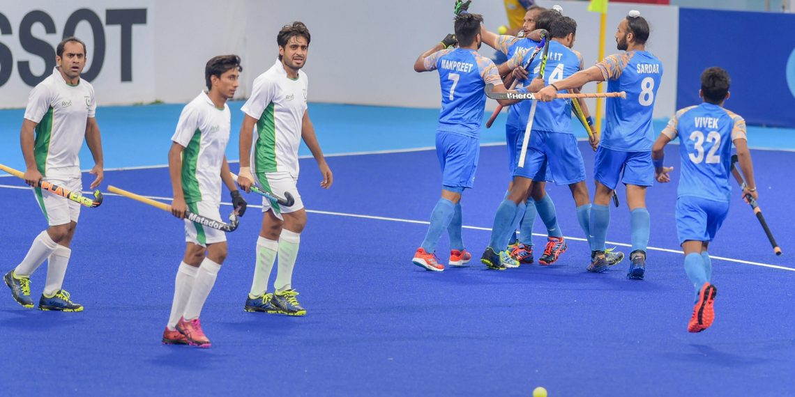 Akashdeep Singh celebrates with teammates after scoring their first goal against Pakistan during their bronze medal match at the Asian Games