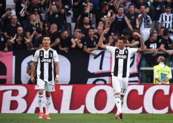 Cristiano Ronaldo (L) looks on as Mario Mandzukic celebrates after scoring against Napoli, Saturday