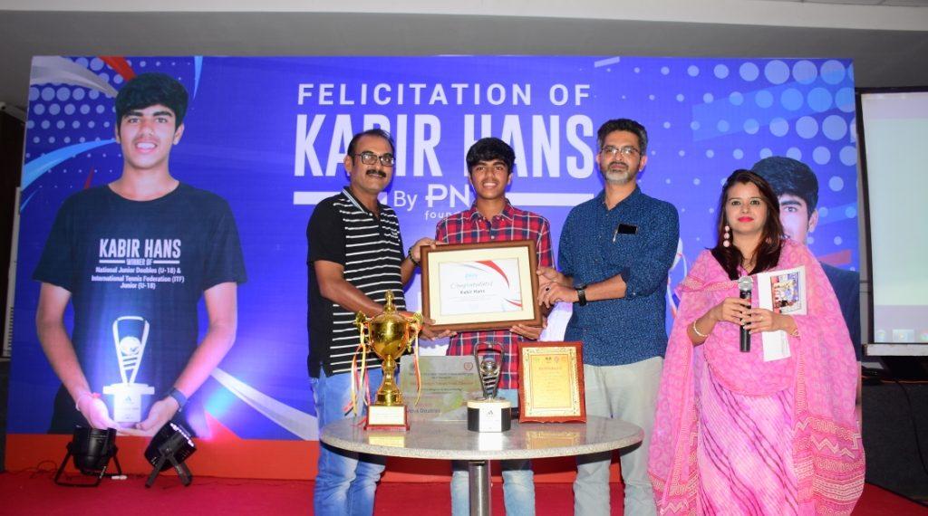 PNV co-founder Satyabrat Sanu Ratho (L) and OFDC chairman Kuna Tripathy felicitating Kabir Hans during a function at the Press Club of Odisha, Friday