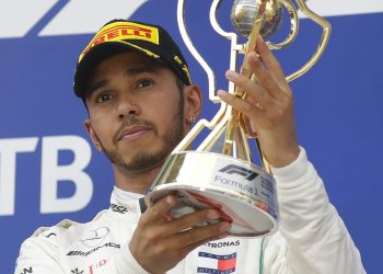 Mercedes driver Lewis Hamilton celebrates with the trophy after winning the Russian Grand Prix at the Sochi Autodrom circuit in Sochi