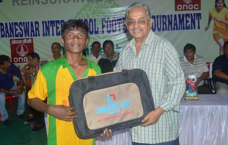 Sundar Mohan Kisko of Unit-I High School receives the man of the match award in Bhubaneswar, Thursday