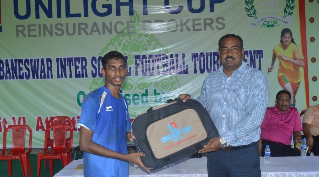 Shivashankar Hembram receives the man of the match award in Bhubaneswar, Sunday