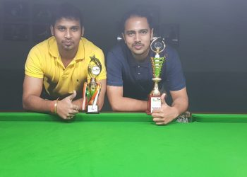 Akash Mohapatra (R) and Jiten Sarangi pose with their trophies at Bhubaneswar, Tuesday