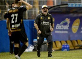 Diego Maradona celebrates after his side's third goal, Monday