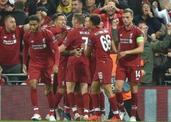 Liverpool players congratulate Roberto Firmino (facing James Milner) after scoring the winner against PSG at Anfield, Tuesday