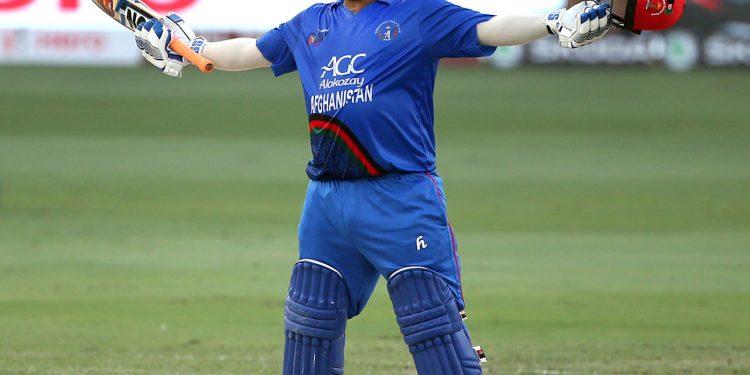 Afghanistan's Mohammad Shahzad celebrates his century against India at Dubai, Tuesday