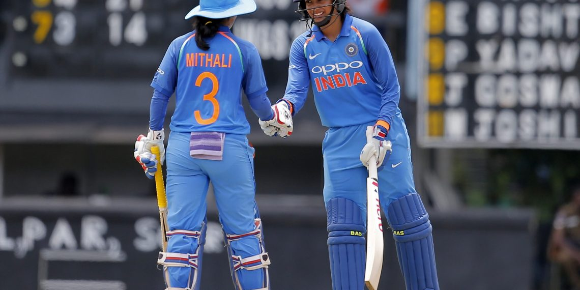 Mithali Raj (L) congratulates Smriti Mandhana for scoring a half century against Sri Lanka during their 3rd ODI