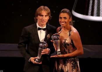 Luka Modric and Marta are all smiles as they pose with their FIFA best player trophies at London, Monday evening