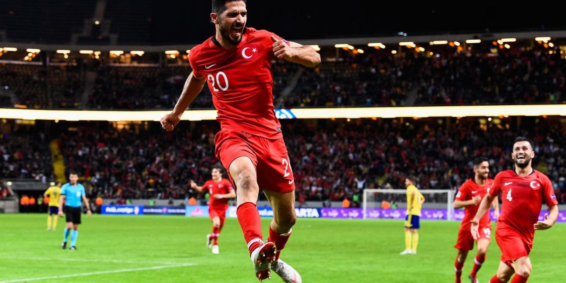 Emre Akbaba celebrates one of his two goals after scoring against Sweden