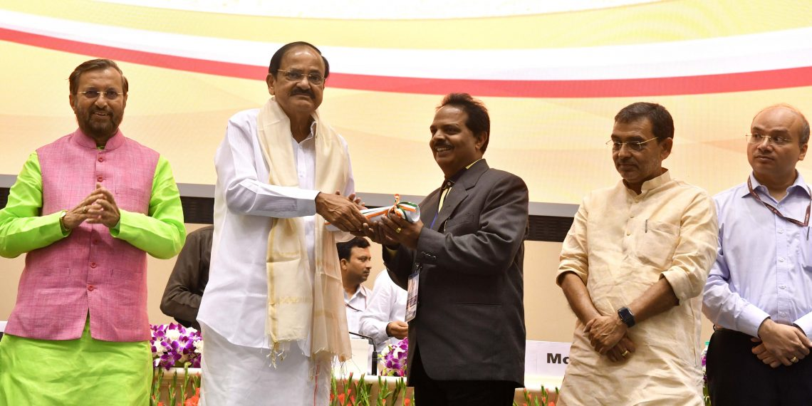 Om Prakash Mishra receives the award from the Vice-President in New Delhi.