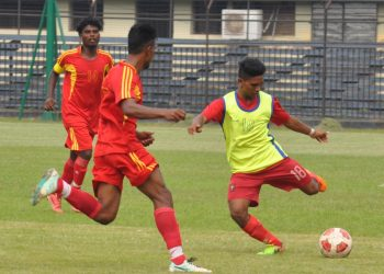 Radhagobinda Club and Rising Star Club players tussle for the ball during their match at Barabati Stadium in Cuttack Friday
