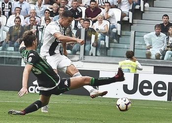 Cristiano Ronaldo of Juventus shoots to score his second goal in the Serie A game against Sassuolo, Sunday