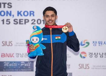 Vijayveer Sidhu poses with his 25m standard pistol junior gold at Changwon, Friday