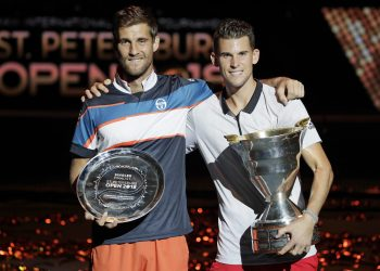 Dominic Thiem (R) and Martin Klizan pose with their trophies in St. Petersburg, Sunday