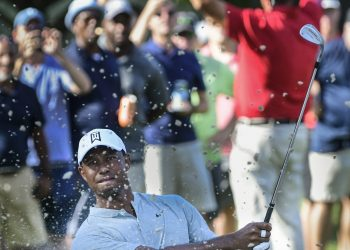 Tiger Woods hits up to the 13th green during the second round of the Tour Championship golf tournament in Atlanta, Friday