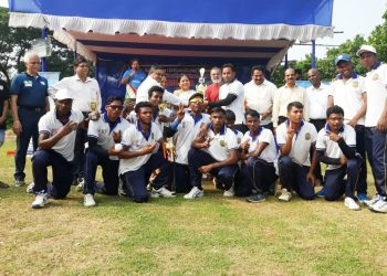 Jubilant Odisha team and officials with the winner's trophy in Bhubaneswar, Sunday