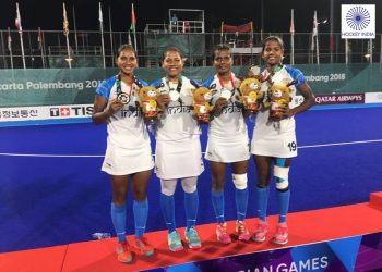 Sunita Lakra, Namita Toppo, Lilima Minz and Deep Grace Ekka pose with their silver medals at Jakarta