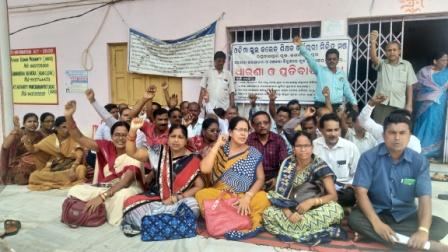 Teachers and employees of Block Grant schools stage a sit-in at Raghunathpur block near Cuttack, Wednesday