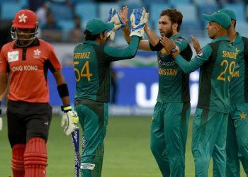 Usman Khan (C) celebrates with teammates after dismissing a Hong Kong batsman in Dubai