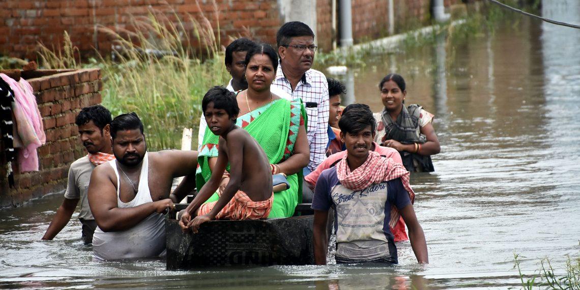 Officials visit Sujata Nagar on a boat, Tuesday OP photo