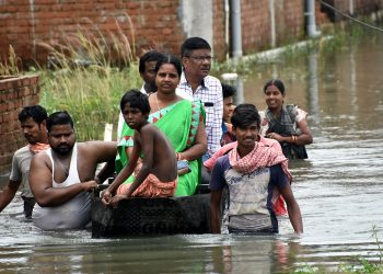 Officials visit Sujata Nagar on a boat, Tuesday OP photo