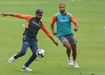 Indian cricketers Shikhar Dhawan and  Ravindra Jadeja play football during a practice session ahead of the first ODI against West Indies