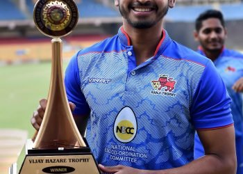 Shreyas Iyer poses with the winner's trophy