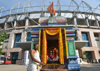 Priest Hamumanth Sharma stands outside the temple at Hyderabad cricket ground before the start of first day's play of second test match between India and West Indies, Friday