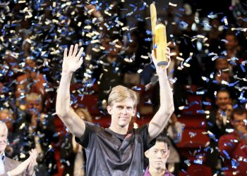 Kevin Anderson poses with the winner's trophy in Vienna, Sunday
