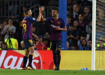 Rafinha (R) celebrates with Jordi Alba after scoring Barcelona's opening goal against Inter, Wednesday