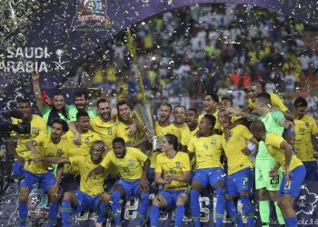 Brazil's Neymar holds the trophy as he celebrates with his teammates after the friendly soccer match against Argentina in Jiddah, Saudi Arabia, Tuesday