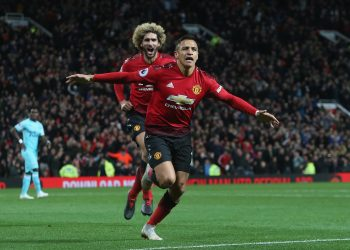 Alexis Sanchez celebrates after scoring the winner against Newcastle United at Old Trafford