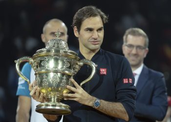 Roger Federer holds the trophy during the victory ceremony At Basel