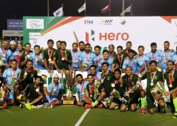 India and Pakistan players pose with the joint winners' trophy and medals in Muscat, Sunday