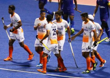 Indian players celebrate after scoring a goal against Malaysia at Johor Bahru, Saturday