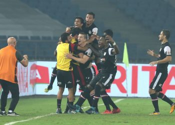 NorthEast United FC players celebrate their opening goal against Delhi Dynamos, Tuesday