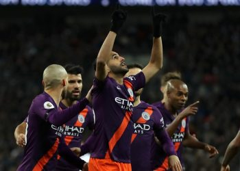 Manchester City's Riyad Mahrez (C) points towards the sky in the memory of his late boss after scoring against Spurs, Monday