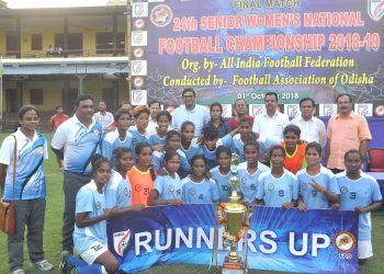 Odisha players pose with their runners-up trophy along with guests and officials at Cuttack, Monday