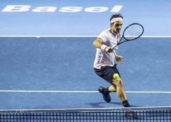 Roger Federer returns a ball to Daniil Medvedev during their semifinal match at the Swiss Indoors tennis tournament