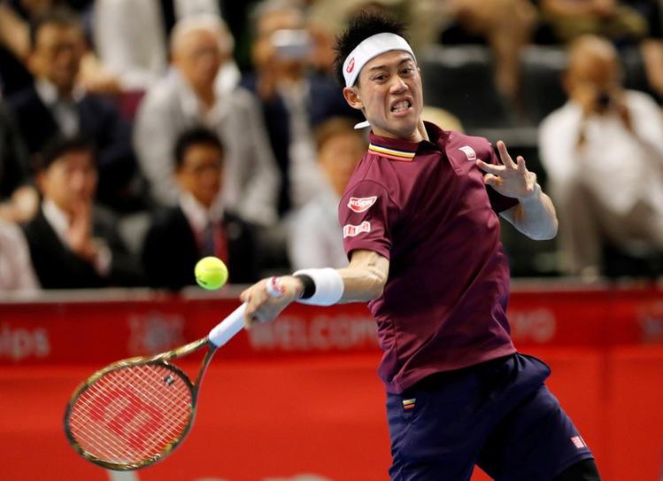 Kei Nishikori plays a shot against Richard Gasquet in Tokyo, Saturday