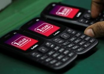 A worker tests a Lava mobile handset at its manufacturing plant in Noida. REUTERS