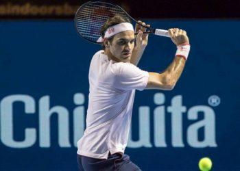 Caption Roger Federer plays a shot against Gilles Simon in Basel, Friday