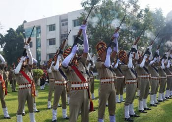 Police personnel pay gun salutes to martyrs during the celebration of 59th state-level Police Commemoration Day in Cuttack, Sunday