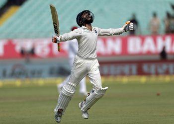 Ravindra Jadeja celebrates his maiden Test century against West Indies in Rajkot